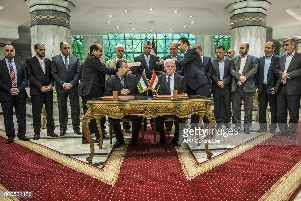Hamas's new deputy leader Salah alAruri and Fatah's Azzam alAhmad sign a reconciliation deal in Cairo on October 12 as the two rival Palestinian...