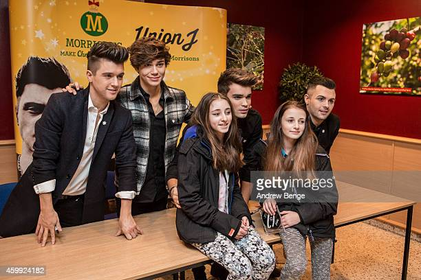 union j sign copies of their single you got it all at morrisons in