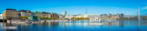 hamburg alster lake fountain hotels and pleasure boats panorama germany - historical geopolitical location stock photos and pictures