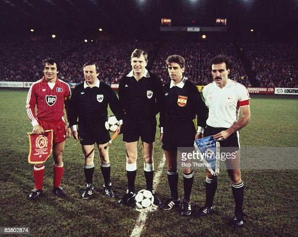 SV Hamburg captain Felix Magath and Aberdeen captain Willie Miller line up with the match officials before the UEFA Super Cup Final 2nd leg at...