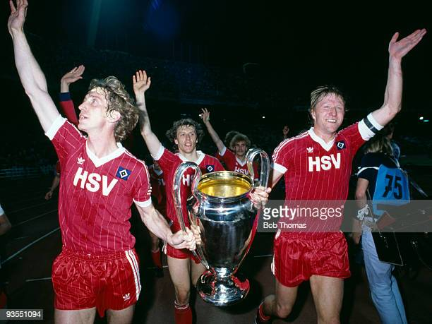 Hamburg captain Horst Hrubesch carries the trophy with teammate Ditmar Jakobs after Hamburg beat Juventus 1-0 to win the European Cup Final held at...