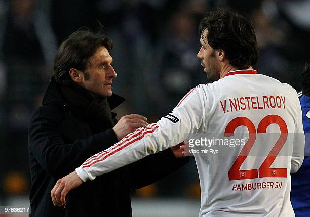 Hamburg coach Bruno Labbadia gives a hug to Ruud van Nistelrooy after the UEFA Europa League round of 16 second leg match between RSC Anderlecht and...