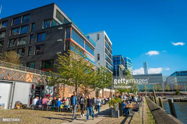 hamburg crowds enjoying sunshine outdoor restaurants hafencity waterfront promenade germany - urban renewal stock pictures, royalty-free photos & images