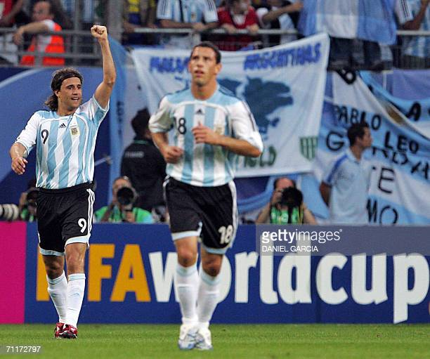 Argentinian forward Hernan Crespo celebrates flanked by Argentinian midfielder Javier Alejandro Mascherano after scoring during the 2006 World Cup...
