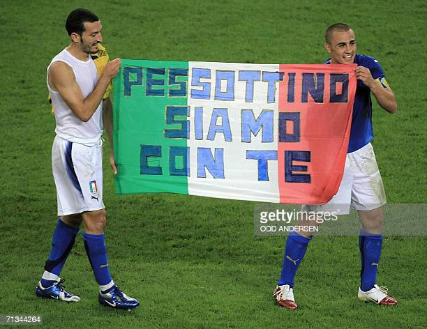 Italian defender Fabio Cannavaro and Italian defender Gianluca Zambrotta hold a banner reading 'Pessotto we are with you' in honour to the former...