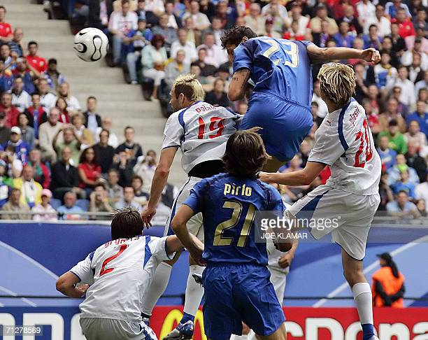 Italian defender Marco Materazzi heads the ball to score the opening goal during the World Cup 2006 group E football game Czech Republic vs. Italy,...