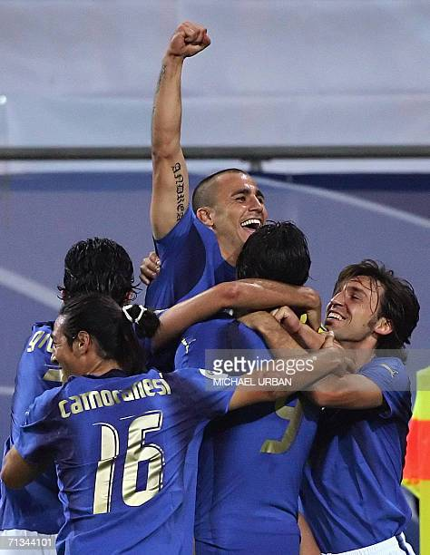 Italian forward Luca Toni is congratulated by Italian defender Fabio Cannavaro after scoring the second goal for his team during the World Cup 2006...
