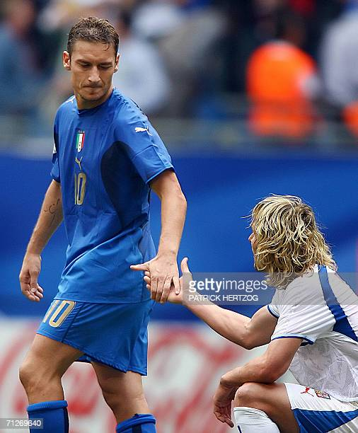 Italian midfielder Francesco Totti shakes hands with Czech midfielder Pavel Nedved at the end of the World Cup 2006 group E football game Czech...