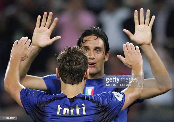 Italian midfielder Gennaro Gattuso and Italian midfielder Francesco Totti celebrate at the end of the World Cup 2006 quarter final football game...