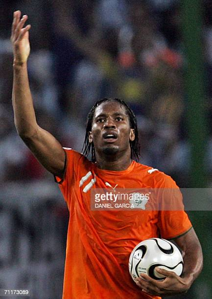 Ivorian forward Didier Drogba celebrates after scoring during the 2006 World Cup group C football game Argentina vs Ivory Coast 10 June 2006 at...