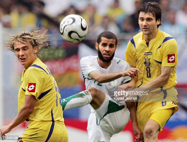 Saudi defender Abdulaziz Khathran is challanged by Ukrainian midfielder Maksim Kalinichenko and midfielder Oleg Shelayev during the World Cup 2006...