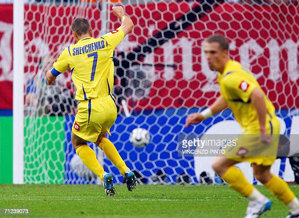 Ukrainian forward Andriy Shevchenko jubilates after Ukrainian midfielder Serhiy Rebrov scored during the World Cup 2006 group H football match Saudi...