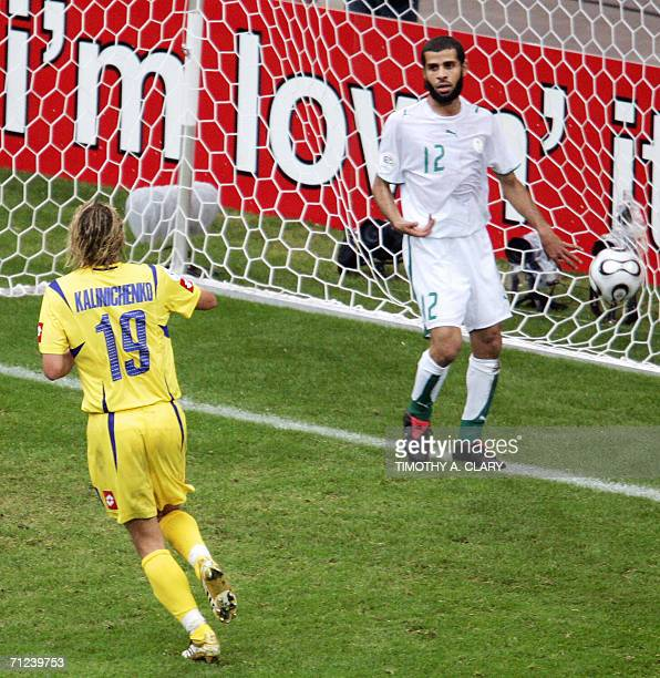 Ukrainian midfielder Maksim Kalinichenko jubilates after scoring as Saudi defender Abdulaziz Khathran looks dejected during the World Cup 2006 group...