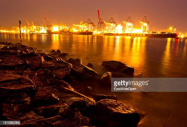 Hamburg Harbour and the Landungsbruecken by night view the beach Ovelgonne on the river Elbe on September 16 2011 in Hamburg GermanyThe beach has a...