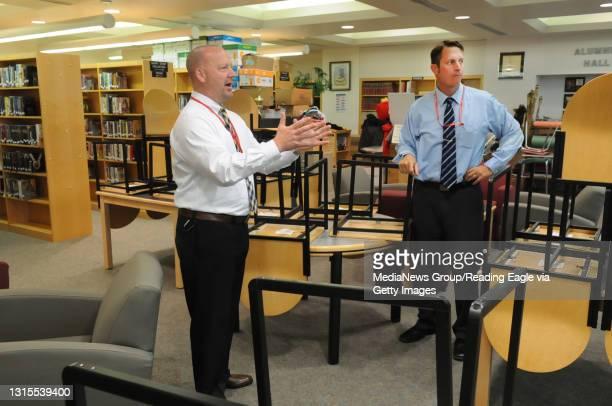 Hamburg High School principals Christopher Spohn, left and Dr. Shawn Gravish discuss changes to be made in the high school library. Hamburg High...