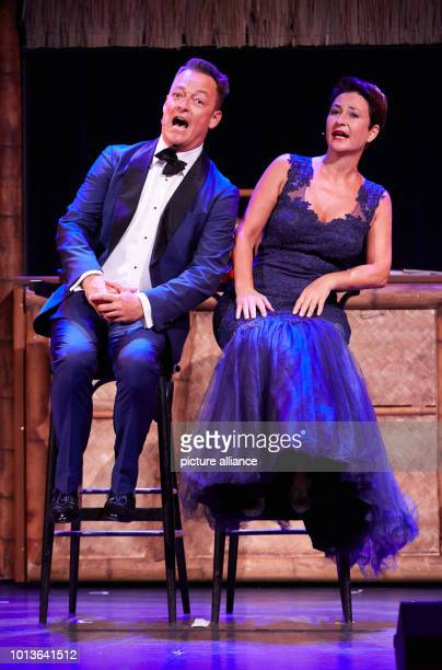 Hubertus Borck and Alexandra Doerk from the cabaret and music duo 'Bo Doerek' perform on stage at the Schmidt Theater during the dress rehearsal for...