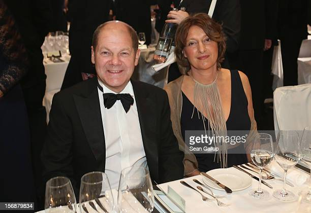 Hamburg Mayor Olaf Scholz and his wife Britta Ernst attend the 2012 Bundespresseball at the Intercontinental Hotel on November 23 2012 in Berlin...