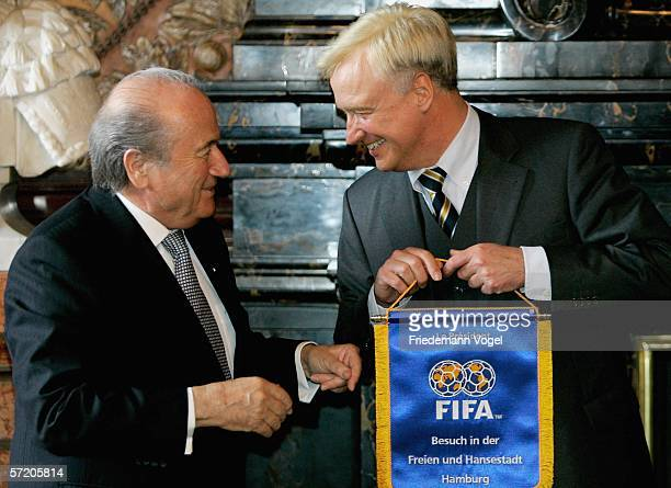 Hamburg mayor Ole von Beust shakes hands with FIFA president Joespeh Sepp Blatter after Blatter signed the 'Golden Book of Hamburg' during the...