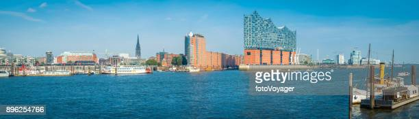 hamburg panoramic view across river elbe city harbour waterfront germany - elbphilharmonie stock pictures, royalty-free photos & images
