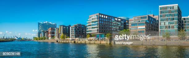 hamburg people enjoying sunshine hafencity modern elbe waterfront panorama germany - western europe stock pictures, royalty-free photos & images