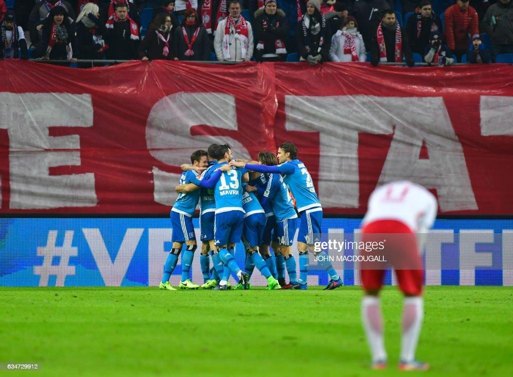Hamburg players celebrate after their third goal during the German First division Bundesliga football match RB Leipzig vs Hamburger SV in Leipzig on February 11, 2017. / AFP / John