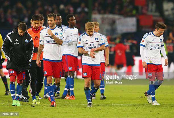 Hamburg players look dejected in defeat after the Bundesliga match between Hamburger SV and FC Bayern Muenchen at Volksparkstadion on January 22 2016...