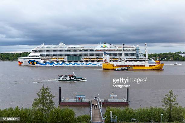 Hamburg, River Elbe meeting of cruiseship and industrial ship