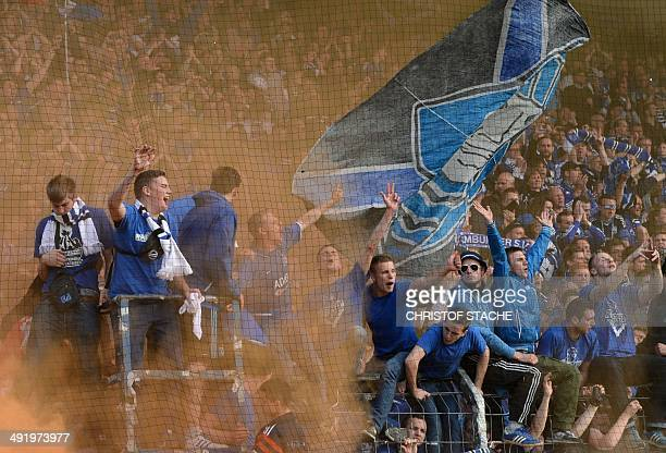 Hamburg supporters celebrate after the secondleg German Bundesliga relegation football match Greuther Fuerth vs Hamburg SV in Fuerth southern Germany...