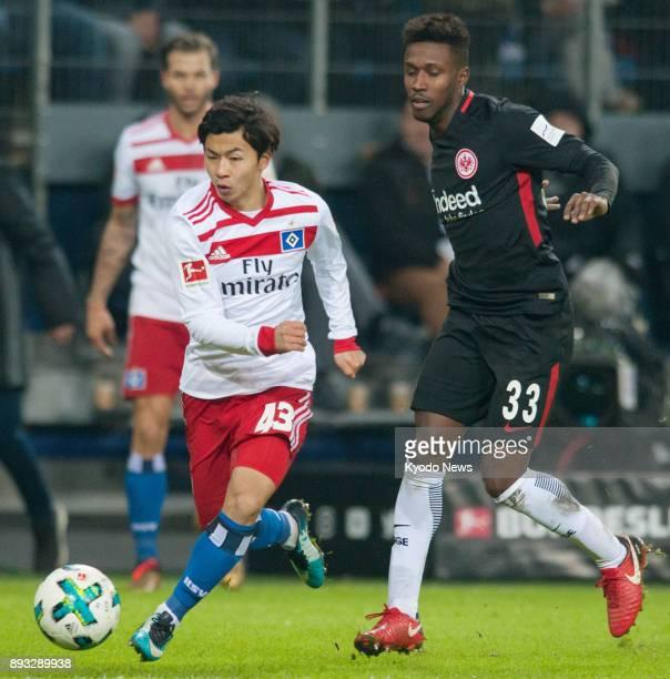 Hamburg SV's Tatsuya Ito and Taleb Tawatha of Eintracht Frankfurt vie for the ball in a Bundesliga match in Hamburg Germany on Dec 12 2017 Hamburg...