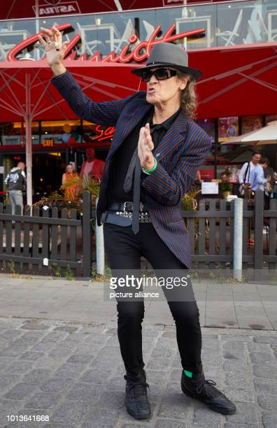 Udo Lindenberg musician posing in front of the Schmidt Theater before the birthday show The Theater an der Reeperbahn celebrates its 30th birthday...