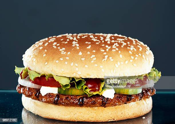 Hamburger against black background, close-up