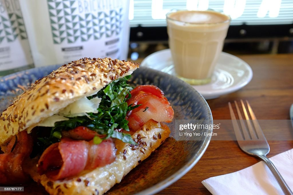 Hamburger And Coffee On Table : Foto stock