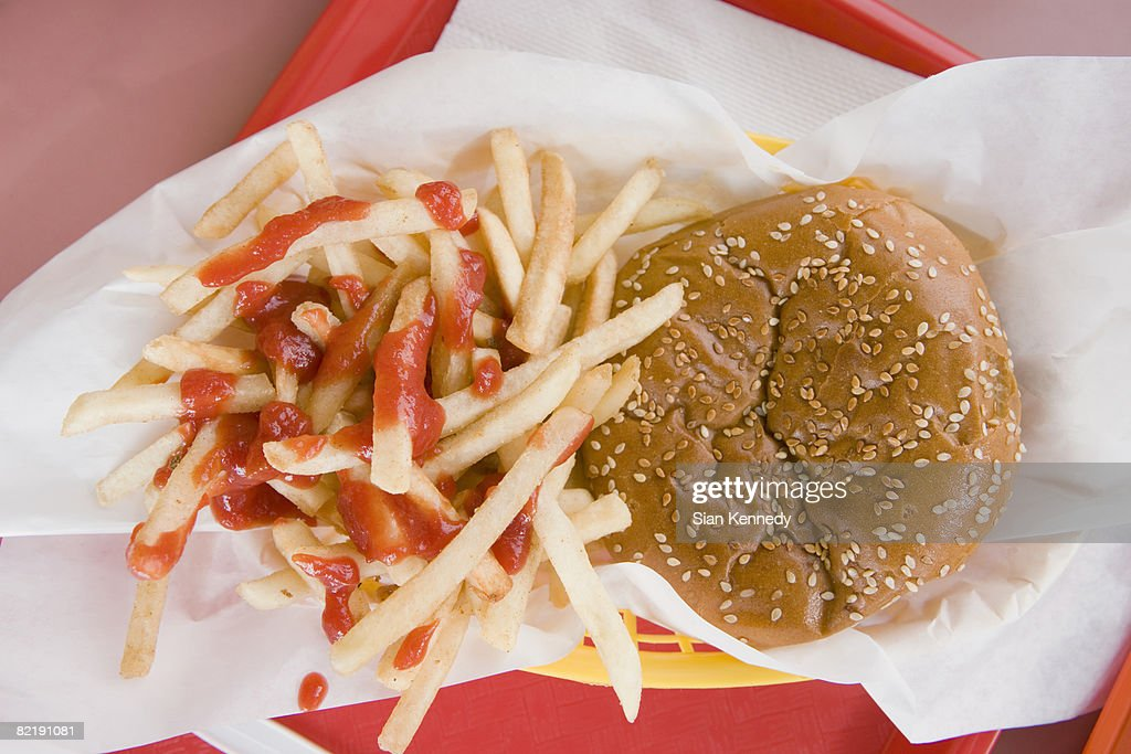 Hamburger and french fries on a fast food tray : Stock Photo