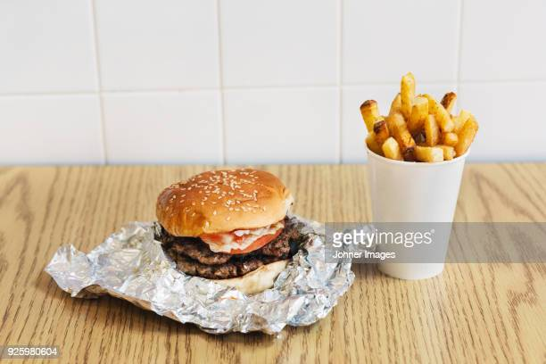 hamburger and fries - unhealthy living stock pictures, royalty-free photos & images