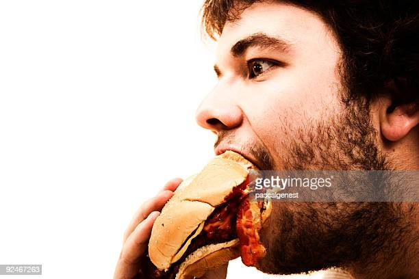 hamburger eater man - evil stock photos and pictures