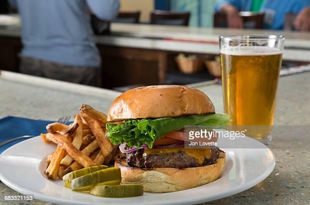 Hamburger on a bar with beer