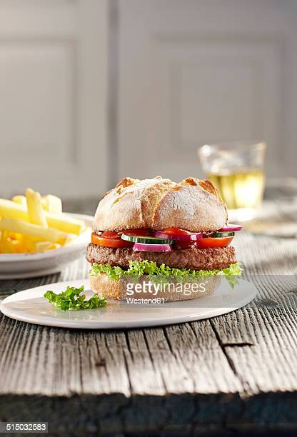 Hamburger on plate and french fries