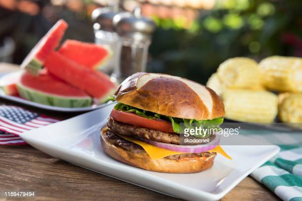 hamburger picnic with watermelon and corn - labor day stock pictures, royalty-free photos & images