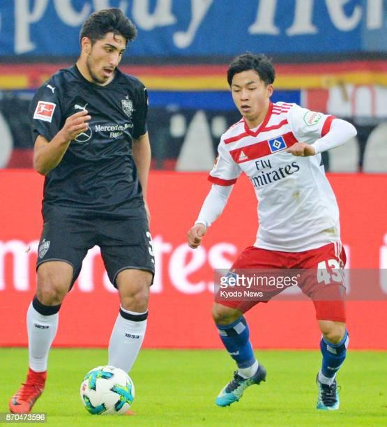 Hamburger SV midfielder Tatsuya Ito closes in on VfB Stuttgart midfielder Berkay Oezcan during a Bundesliga match at Volksparkstadion in Hamburg...