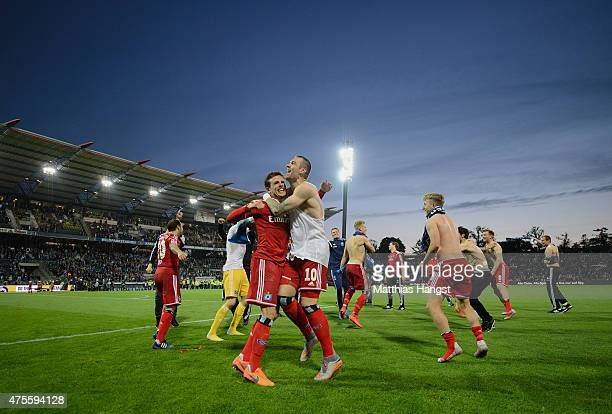 Hamburger SV players and staff celebrate victory after the Bundesliga playoff second leg match between Karlsruher SC and Hamburger SV at Wildpark...