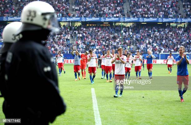Hamburger SV players applaud the fans after their relegation after the Bundesliga match between Hamburger SV and Borussia Moenchengladbach at...