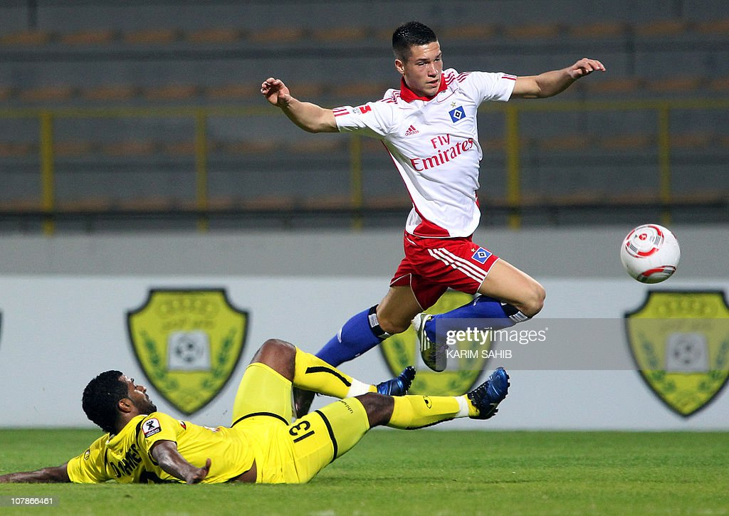 Hamburger SV's Muhamed Besic Jumps Over UAE Al-Wasl's
