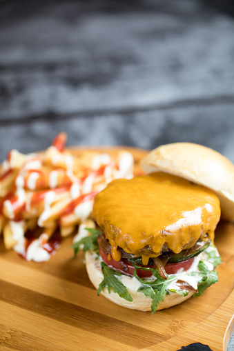 Hamburger with french fries served on wooden plate - gettyimageskorea