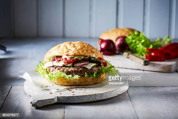 Hamburger with ground beef on chopping board