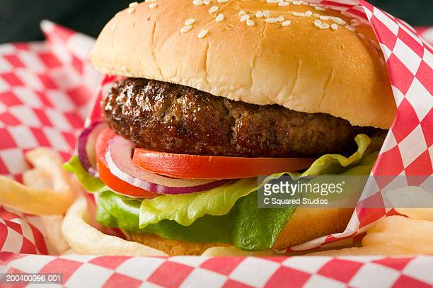 hamburger with lettuce, tomato, red onion and french fries - ハンバーガー ストックフォトと画像