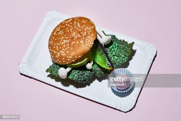 hamburger with toy fish on paper plate - paper plate stock photos and pictures