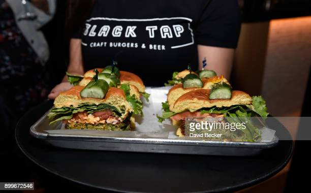 Hamburgers are served during the grand opening of Black Tap Craft Burgers Beer at The Venetian Las Vegas on December 29 2017 in Las Vegas Nevada