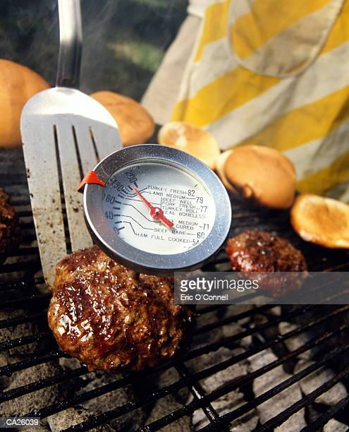 Hamburgers cooking on barbecue, close-up