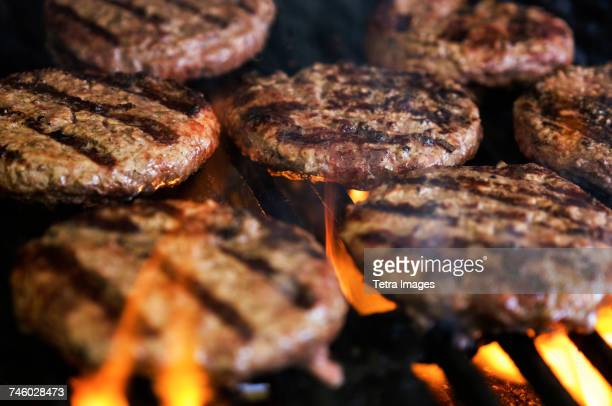 hamburgers on barbeque grill - hamburger stock pictures, royalty-free photos & images