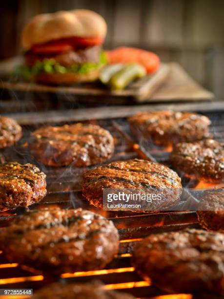 hamburgers on the bbq - burger stock pictures, royalty-free photos & images